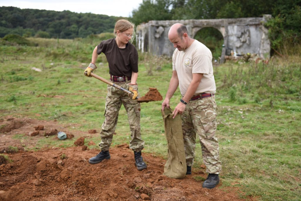Army Reserve Royal Engineers from South Wales and Bristol fill sandbags for battle trench fortifications during weekend training