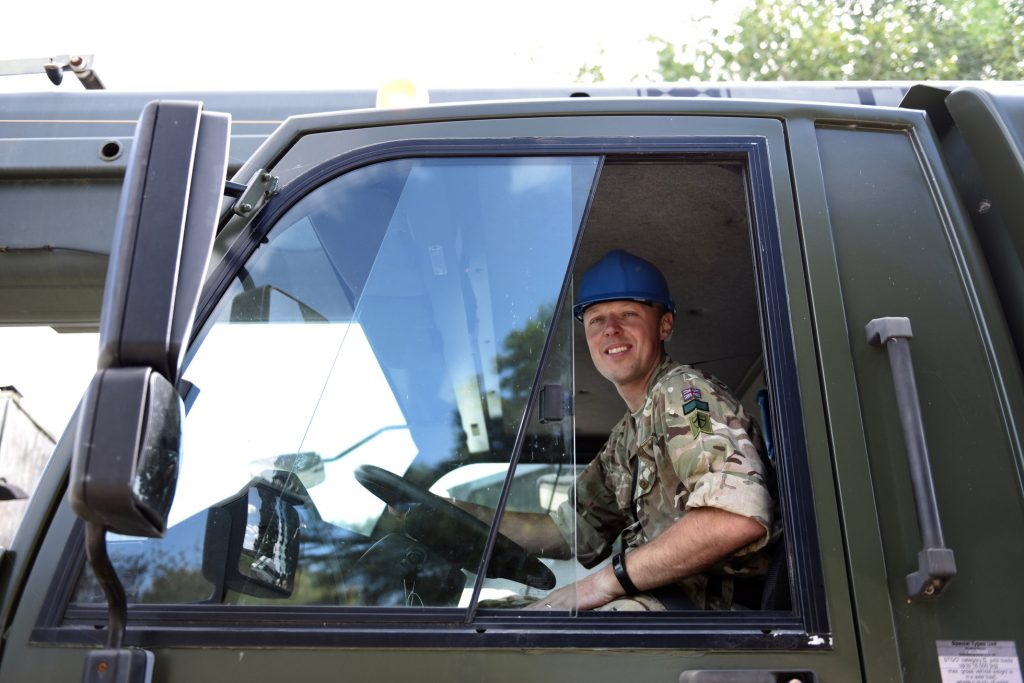 Army Reserve Royal Engineer crane operator in cab