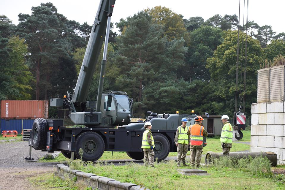 Reserve Royal Engineer sappers from south wales and west midlands train in the use of a crane