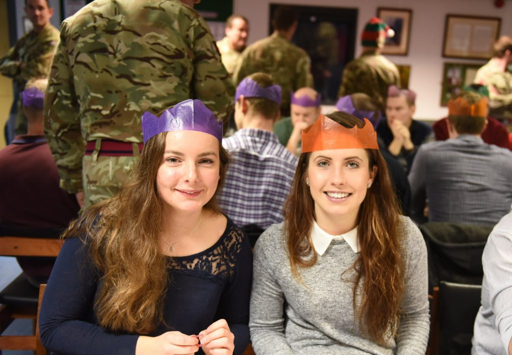 Two female soldiers of The Royal Monmouthshire Royal Engineers (Militia) wait for the Officers and Senior NCOs to bring them their Christmas dinner at the 2016 Christmas weekend