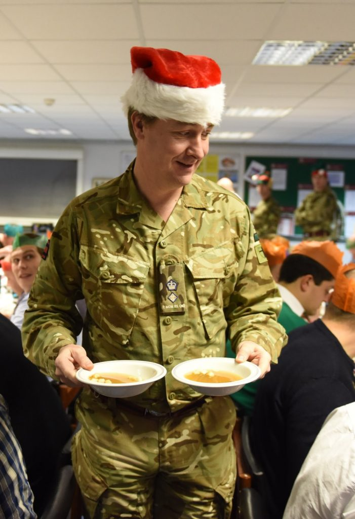 The Commanding Officer serves dinner to his soldiers at The Royal Monmouthshire Royal Engineers (Militia) 2016 Christmas weekend