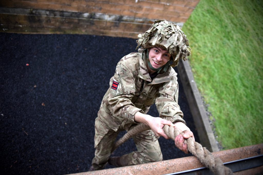 An Army Reserve Royal Engineer soldier from The R Mon REM on the confidence course at Copehill Down during FIBUA training.