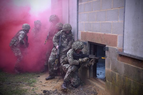 Army Reserve soldiers of The R Mon RE(M) force entry into a house during FIBUA training in Copehill Down training facility.