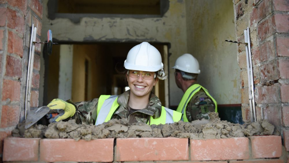 Female Army Reserve Royal Engineer from the South Wales based sub unit of The Royal Monmouthshire Royal Engineers (Militia) practices bricklaying as part of the buildup to #ExRESOLUTECASTLE