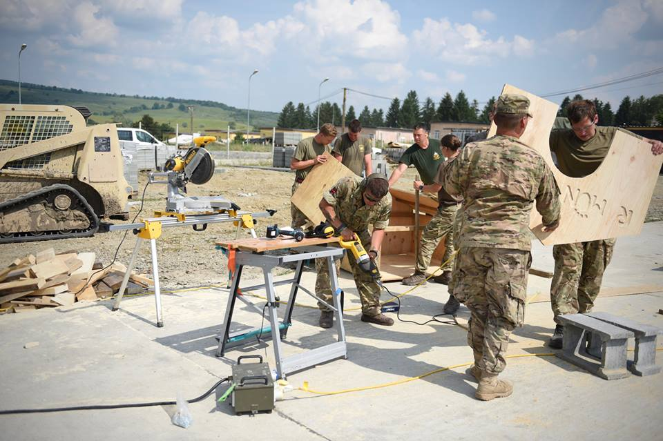 Army Reserve Royal Engineers from The R Mon RE(M) work on a kennel for local stray puppies.