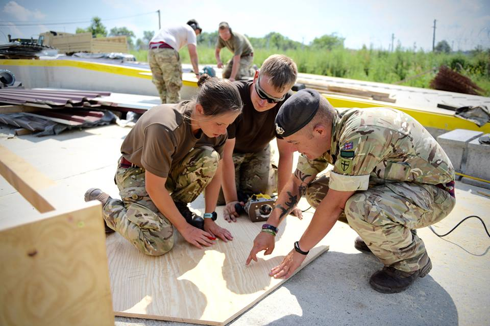 Army Reserve Royal Engineers from The R Mon RE(M) begin work on a kennel for some Romanian stray puppies.
