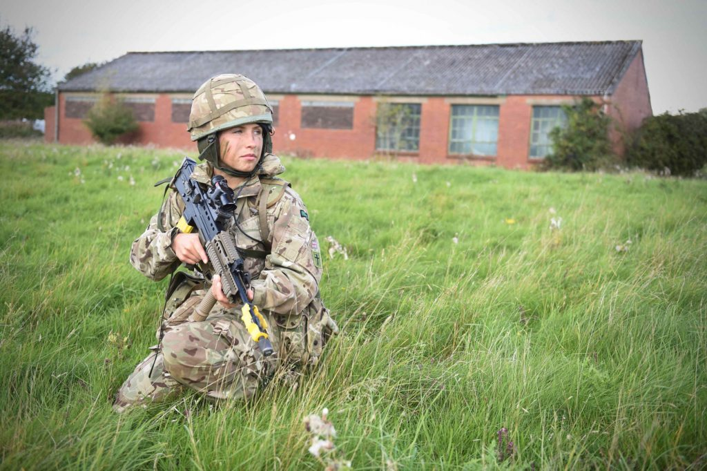 A female British Army Reservist Royal Engineer of The Royal Monmouthshire Royal Engineers (Militia) keeps watch during a 'back to basics' soldier training weekend