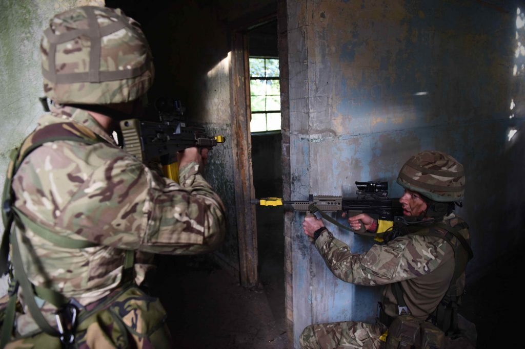 British Army Reserve Royal Engineers of The Royal Monmouthshire Royal Engineers (Militia) practice conducting building clearance on a 'back to basics' soldier training weekend