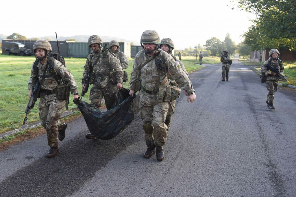British Army Reserve Royal Engineers of The Royal Monmouthshire Royal Engineers (Militia) conduct a simulated casualty extraction during a 'back to basics' soldier training weekend