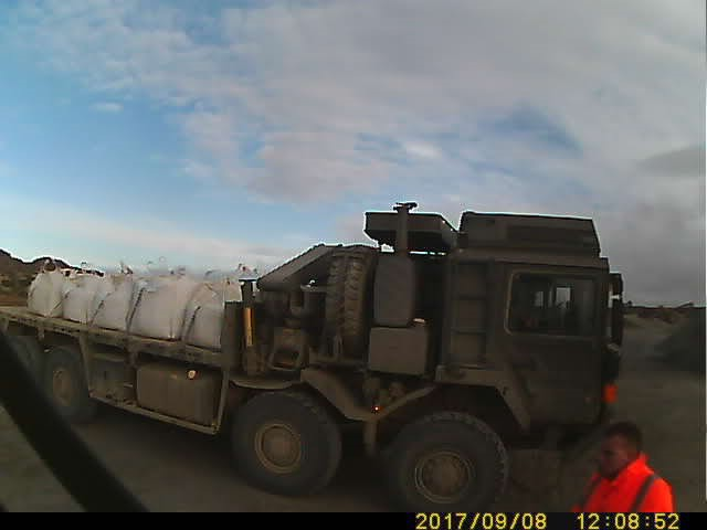 An Army Reservist from The Royal Monmouthshire Royal Engineers' laden truck carrying aggregate on the Falkland Islands as part of Project ANEMOI