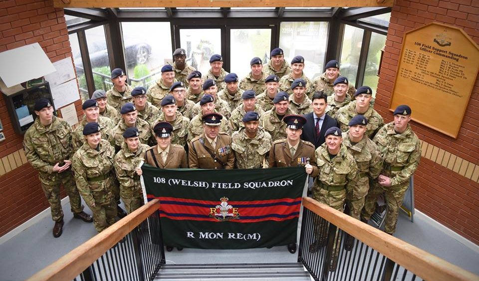 British Army Reserve officers and soldiers of 108 (Welsh) Field Squadron (Militia) parade behind the flag before raising it as part of their reformation parade
