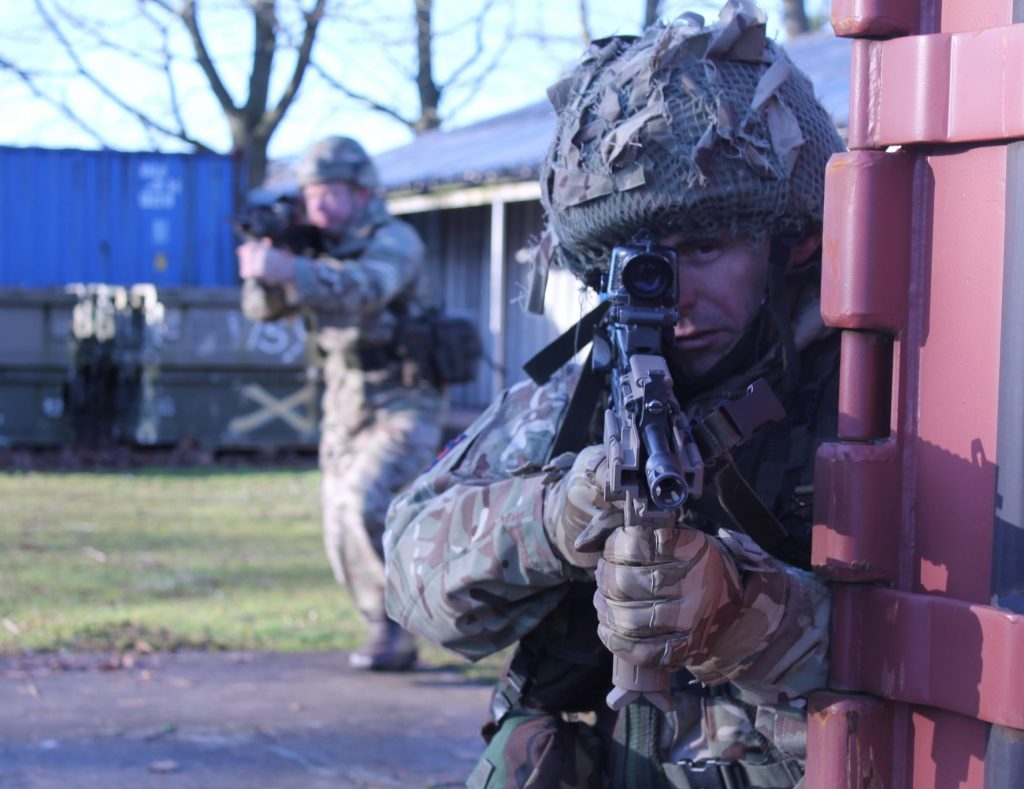Army Reserve Royal Engineers conduct a battle run during training for Op TRENTON