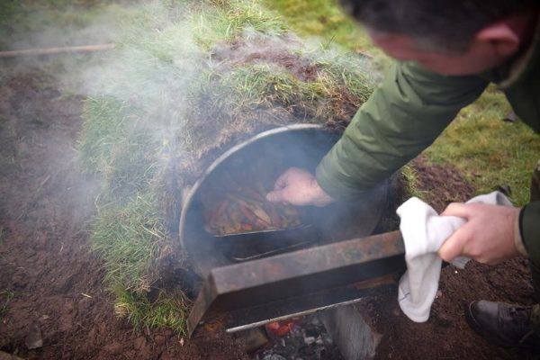Army Reserve chefs cook a meal using an improvised stove.
