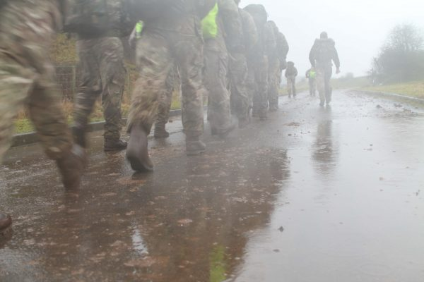 British Army Royal Engineer Reservists who have volunteered to deploy on Op TRENTON in South Sudan in support of the UN mission there prepare by undertaking an 8 mile loaded march cooled by the Welsh rain.