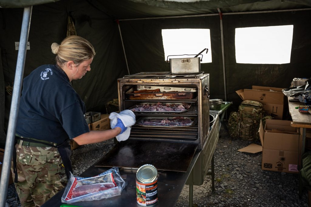An Army Reservist chef of The Royal Monmouthshire Royal Engineers (Militia) prepares food for the other soldiers during Ex MILITIA THUNDER 18, the 2018 Annual Camp for this Royal Engineer unit.