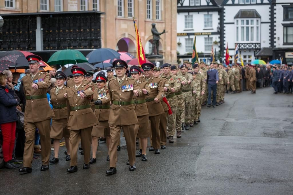 Army Reserve soldiers of The Royal Monmouthshire Royal Engineers (Militia) with veterans, cadets and others pay their respects to the fallen on the Centenary Remembrance Parade in Monmouth, Sunday 11th November 2018.